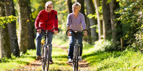 Retirement couple cycling